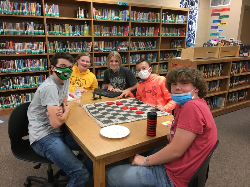 Middle School Students playing checkers